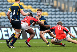 Jake Leonard (Worcester Sixth Form College) of Worcester Warriors U18 is tackled by Andy Boye and Oscar Furneaux of Saracens U18 - Rogan Thomson/JMP - 16/02/2017 - RUGBY UNION - Sixways Stadium - Worcester, England - Worcester Warriors U18 v Saracens U18 - Premiership Rugby Under 18 Academy Finals Day 5th Place Play-Off.