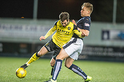 Livingston Liam Buchanan tackled by Falkirk's Peter Grant. Falkirk 2 v 0 Livingston, Scottish Championship game played 29/12/2015 at The Falkirk Stadium.