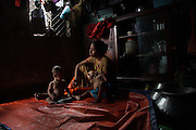 Being unable to breast feed, this worker is bound to leave her job with a heavy pain in neck and chest. August 2009. Mirpur, Dhaka, Bangladesh.