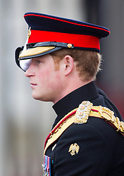 LONDON- UK - 14-JUNE-2014: The annual Trooping the Colour Ceremony for Queen Elizabeth;s Birthday is held in London. Members of the royal family travel by carriage from Buckingham Palace to Horseguards Parade for the Trooping Ceremony.<br /> Prince Harry<br /> Photograph by Ian Jones
