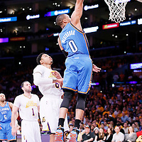 09 March 2014: Oklahoma City Thunder point guard Russell Westbrook (0) goes for the dunk during the Los Angeles Lakers 114-110 victory over the Oklahoma City Thunder at the Staples Center, Los Angeles, California, USA.