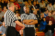 30 DEC. 2011 -- KIRKWOOD, Mo. -- The officials share a laugh during a fourth quarter timeout during the championship game pitting St. Jon Vianney High School and Christian Brothers College High School at the 34th Meramec Holiday Festival High School Basketball Tournament at St. Louis Community College - Meramec in Kirkwood, Mo. Friday, Dec. 30, 2011. Vianney topped CBC 66-57. Photo © copyright 2011 Sid Hastings.