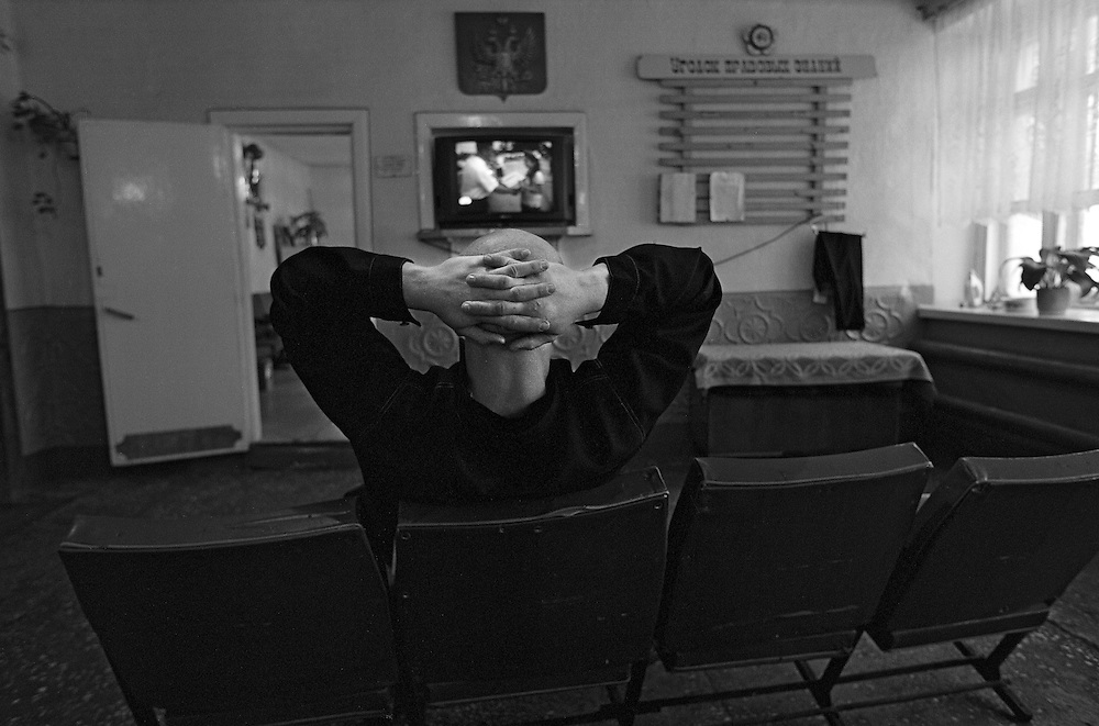 Russian young prisoner watches TV set in the rest room of the colony for prisoner's children in Siberian town Leninsk-Kuznetsky, Russia, 16 January 2001.