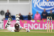 Ollie Pope of Surrey dives to make a quick single to bring up his 50 during the Specsavers County C'ship Div One match at the Kia Oval, London<br /> Picture by Simon Dael/Focus Images Ltd 07866 555979<br /> 11/05/2018
