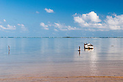 A lone boat sits in Kaneohe Bay in Hawaii.