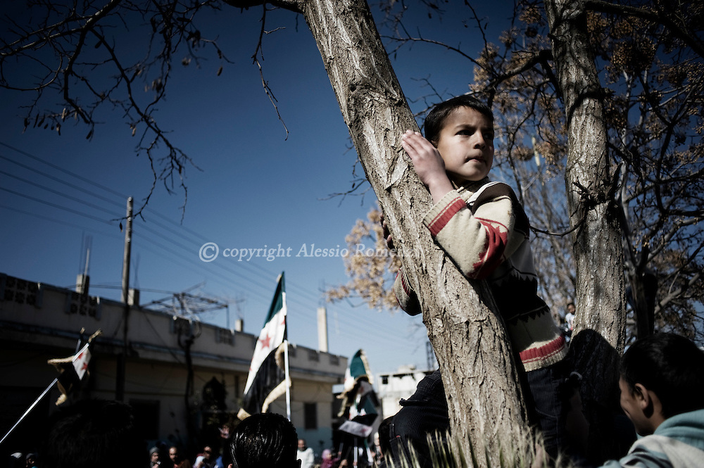 SYRIA - Homs province: This picture shows a child as he is watching an anti-regime demonstration in Homs province on February 20, 2012. ALESSIO ROMENZI