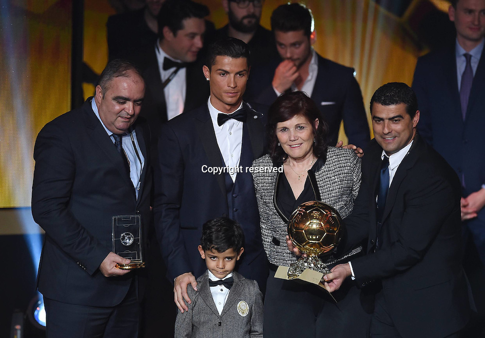 12.01.2015. Zurich, Switzerland. FIFA Ballon d'Or Gala 2014 held at the Kongresshaus in Zurich, Switzerland.   Cristiano Ronaldo (Real Madrid / Portugal) with his Family and the Golden Ball