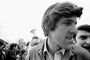 On April 22, 1971, Vietnam veteran Lt. John Kerry became the first Vietnam veteran to testify before Congress about the war, when he appeared before a Senate committee hearing on proposals relating to ending the war.<br /> Kerry , the following day -April 23, 1971 -  participated in a demonstration with thousands of other veterans in which he and other veterans threw their medals and ribbons over a fence erected at the front steps of the United States Capitol building to dramatize their opposition to the war.<br /> Here, Kerry is shown quickly turning from the podium just after delivering an antiwar speech to the thousands of gathered protestors. - To license this image, click on the shopping cart below -