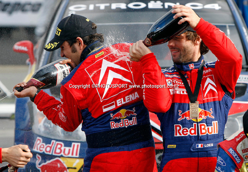 Winners Sebastien Loeb (R) and co driver Daniel Elena spray the champagne.<br />