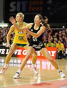 Irene Van Dyk looks for the ball. Constellation cup netball. Silver Ferns v Australian Diamonds at ILT Velodrome, Invercargill, New Zealand. Sunday 15th september 2013. New Zealand. Photo: Richard Hood/photosport.co.nz