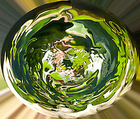 round green vortex with many green and white shades and tones on blurred background
