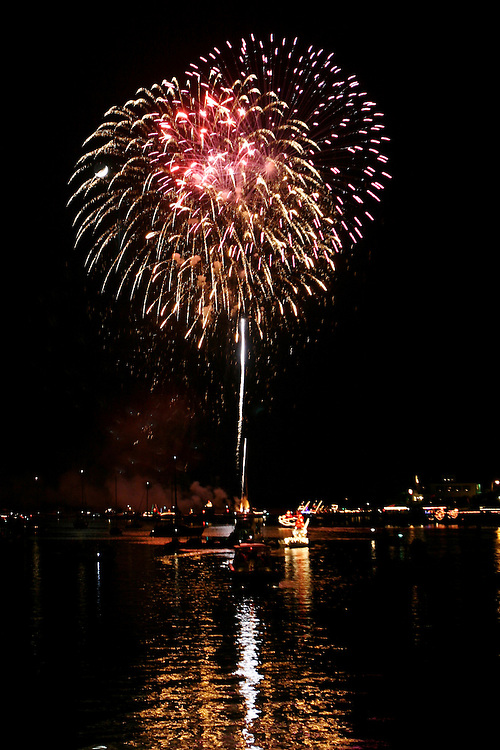 Fireworks alight the sky over Banks Channel in Wrightsville Beach for the finale of the North Carolina Holiday Flotilla...Photo by Logan Mock-Bunting