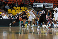 November 27, 2008: San Diego State's Kyle Spain (15) drives against Western Carolina's Brandon Giles (1) in the final game in the opening round of the 2008 Great Alaska Shootout at the Sullivan Arena