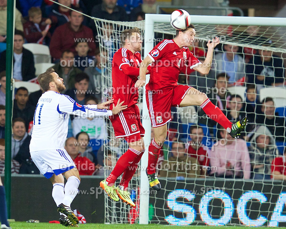 13.10.2014, City Stadium, Cardiff, WAL, UEFA Euro Qualifikation, Wales vs Zypern, Gruppe B, im Bild Wales' James Chester and Chris Gunter in action against Cyprus // 15054000 during the UEFA EURO 2016 Qualifier group B match between Wales and Cyprus at the City Stadium in Cardiff, Wales on 2014/10/13. EXPA Pictures &copy; 2014, PhotoCredit: EXPA/ Propagandaphoto/ David Rawcliffe<br /> <br /> *****ATTENTION - OUT of ENG, GBR*****