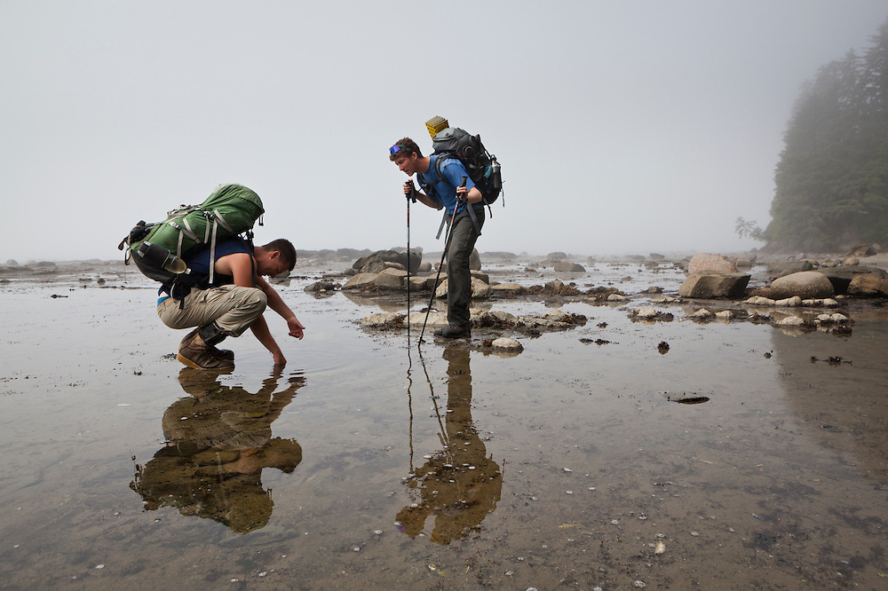 Henry (left) and Zach Podell-Eberhardt search tide pools for life near Bonilla Point, West Coast Trail, British Columbia, Canada.