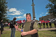"George Peterson was part of a group that  gathered in front of Lee Circle on Sunday morning to protect Lee Circle, one of the Confererate Monuments slated to be taken down, from the ""Antifa"". Peterson is against the monuments being removed. He is also against white supremists, and wants to be sure people don't mix up people who are against communists, and the Antifa with racists."