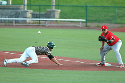 29 July 2016: Ty Morris dives back to first as a pick off attempt throw arrives to /jose Barraza during a Frontier League Baseball game between the Lake Erie Crushers and the Normal CornBelters at Corn Crib Stadium on the campus of Heartland Community College in Normal Illinois