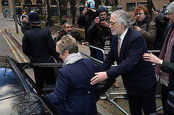 Dave Lee Travis helps his wife Marianne Griffin into a car while leaving Southwark Crown Court after being found not guilty of all but two charges.<br />  Thursday, 13th February 2014. Picture by Ben Stevens / i-Images