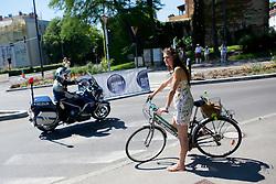 Policeman and girl on bicycle at prologue (17,8km) of Tour de Slovenie 2012, on June 17 2012, in Ljubljana, Slovenia. (Photo by Matic Klansek Velej / Sportida.com)