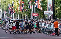 "Competitors in the ""Le Mans"" style start of The Brompton World Championship. Saturday 28th July 2018<br /> <br /> Photo: Bob Martin for Prudential RideLondon<br /> <br /> Prudential RideLondon is the world's greatest festival of cycling, involving 100,000+ cyclists - from Olympic champions to a free family fun ride - riding in events over closed roads in London and Surrey over the weekend of 28th and 29th July 2018<br /> <br /> See www.PrudentialRideLondon.co.uk for more.<br /> <br /> For further information: media@londonmarathonevents.co.uk"