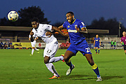 AFC Wimbledon striker Tyrone Barnett (23) and Swansea City U23 defender Tyler Reid (47) during the EFL Trophy match between AFC Wimbledon and U23 Swansea City at the Cherry Red Records Stadium, Kingston, England on 30 August 2016. Photo by Stuart Butcher.
