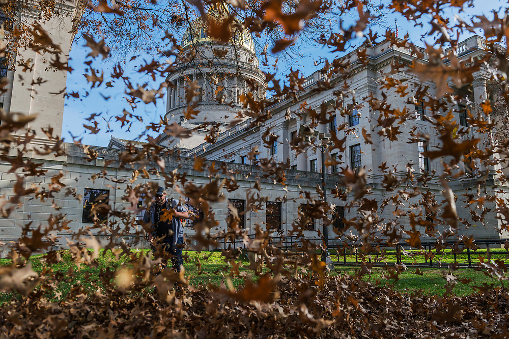 General Service worker Drew Mitchell uses a leaf blower to remove dead leaves from the Capitol lawn in Charleston, W.Va., on Monday, December 04, 2017.