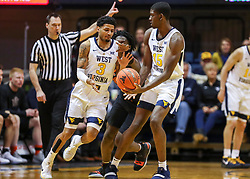 Jan 12, 2019; Morgantown, WV, USA; West Virginia Mountaineers forward Lamont West (15) hands the ball off to West Virginia Mountaineers guard James Bolden (3) during the first half against the Oklahoma State Cowboys at WVU Coliseum. Mandatory Credit: Ben Queen-USA TODAY Sports