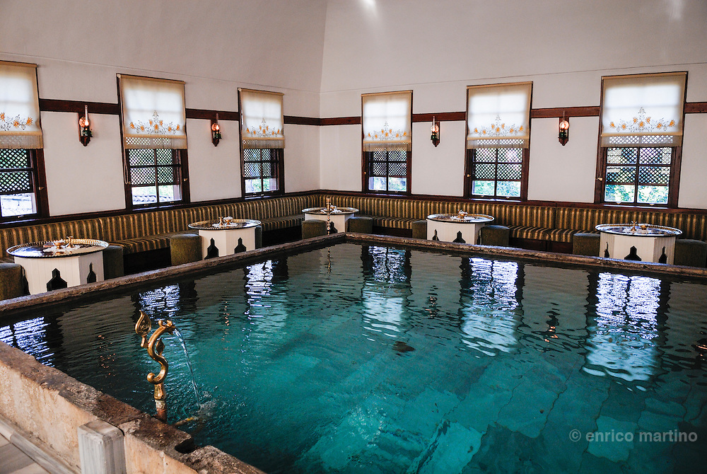 """Safranbolu, Havuzlu Asmazlar Konagi is the most atmospheric hotel in a restored Ottoman traditional old houses. A fine beautiful pool is right on the centre of the main room (Havuzlu means with pool""""9): This pool is the best of the indoor pools of Safranbolu, utilised not for swimming but to cool the room and gave a pleasant background sound. Safranbolu has a beautifully preserved collection of old Ottoman houses and is a UNESCO World Heritage Site. During the 17th century Safranbolu was on the main Ottoman trade road between Gerede and the Black Sea harbours, bringing commerce and wealth to the town. During 18th and 19th centuries wealthy inhabitants built mansions of sun-dried mud bricks, wood and stucco."""