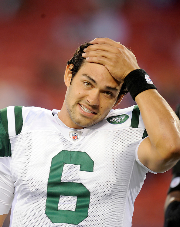 EAST RUTHERFORD, NJ - AUGUST 29: Mark Sanchez #6 of the New York Jets puts his hand on his forhead before a game against the New York Giants in a preseason game at Giants Stadium on August 29, 2009 in East Rutherford, New Jersey. The New York Jets beat the New York Giants 27-25. (Photo by Rob Tringali/ ) *** Local Caption *** Mark Sanchez
