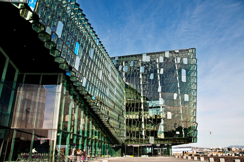 Harpa is a concert hall and conference centre, on the waterfront, in Reykjavík, Iceland. The building is made up of irregularly shaped multi-coloured glass panels.