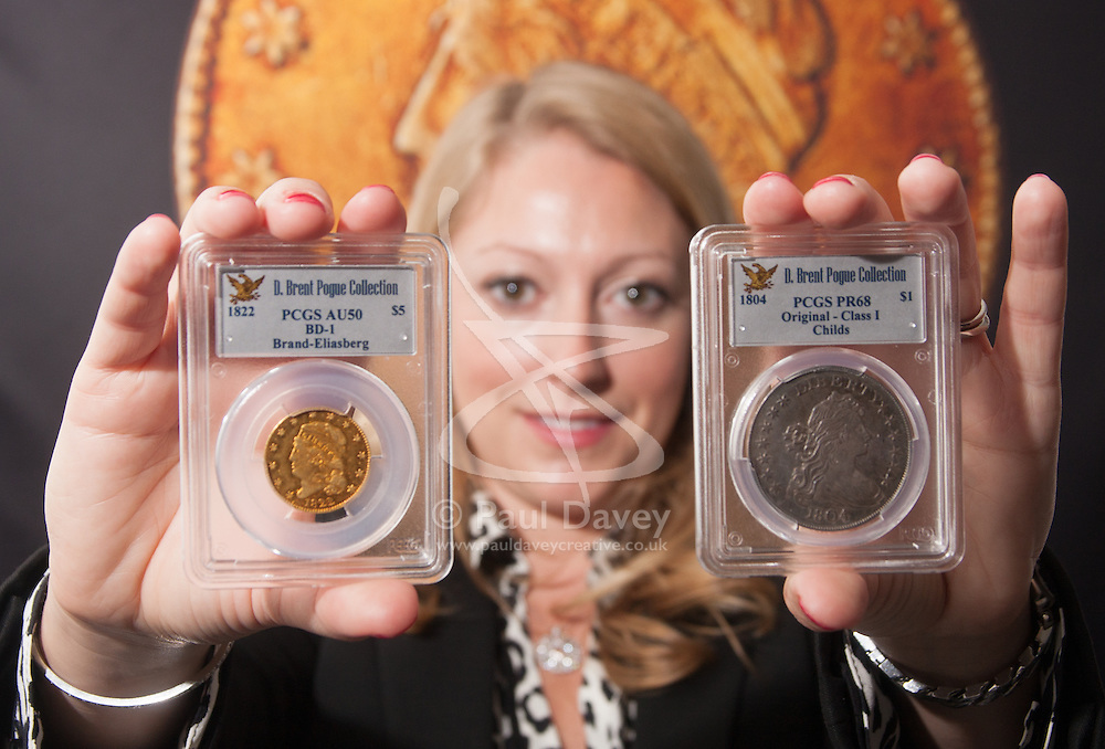 London, March13th 2015. Ahead of the first sale of the D. Brent Pogue rare United States Federal coin  collection sale to be held at Sotheby's  New York. The collection is composed of over 650 gold, silver, and copper coins, and is expected to be the most valuable collection of coins ever sold. PICTURED: Two of the sale's star attraction, left,an 1822 Five Dollar gold piece, the only example in private hands, which is anticipated to sell for up to US$10 million and right, the 1804 Silver Dollar originally presented to the Sultan of Muscat in 1835. It is anticipated to fetch up to $10 million
