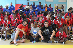 August 4, 2011; Philadelphia, PA; USA; Charlie Brenneman & Dominick Cruz pose for pictures with children at the Boys & Girls Club in Philadelphia.