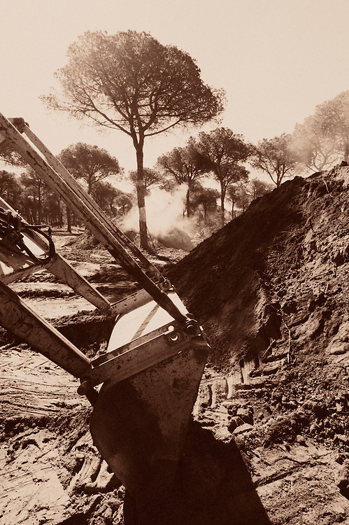 Tractor for covering  charcoal mounds, Andalucia, Spain
