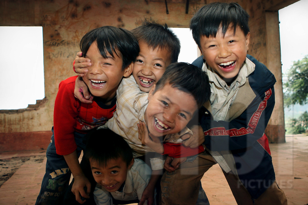 Kids have a good laugh in front of the camera. Ha Tay province, Vietnam, Asia
