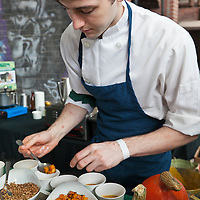A young chef prepares a squash dish at Slow Food's Picnic at the Brick Works in Toronto, 2010.