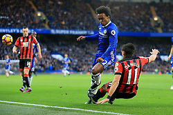 Charlie Daniels of Bournemouth clears the ball, under pressure from Willian of Chelsea - Mandatory by-line: Jason Brown/JMP - 26/12/2016 - FOOTBALL - Stamford Bridge - London, England - Chelsea v Bournemouth - Premier League