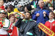 CAPE TOWN, SOUTH AFRICA, MONDAY 21 June 2010, a man blows a vuvuzela during the match between Portugal and Korea PRK held at the new Cape Town Stadium in Green Point during the 2010 FIFA World Cup..Photo by Roger Sedres/Image SA