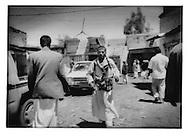 7..Tribesman carries two rifles at the gunrunners? suq near Saudi border, Suq al Talh, Sadah Governate.