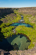 Scenic view of plunge pools and crystal blue water at Box Canyon State Park in Wendell, Idaho.