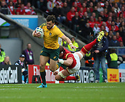 Australia's wing Adam Ashley-Cooper beating the tackle of Wales Alun Wyn Jones during the Rugby World CupPool A match between Australia and Wales at Twickenham, Richmond, United Kingdom on 10 October 2015. Photo by Matthew Redman.