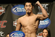 LAS VEGAS, NEVADA, JULY 10, 2009: Dong-Hyun Kim poses on the scales during the weigh-in for UFC 100 inside the Mandalay Bay Events Center in Las Vegas, Nevada