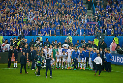 PARIS, FRANCE - Sunday, July 3, 2016: Iceland take a team photograph in front of their supporters after losing 5-2 to France the UEFA Euro 2016 Championship Semi-Final match at the Stade de France. (Pic by Paul Greenwood/Propaganda)