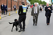 Security tight and a sniffer dog in action outside the course at the York Dante Meeting at York Racecourse, York, United Kingdom on 17 May 2018. Picture by Mick Atkins.