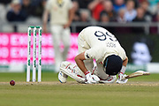 Joe Root of England takes a blow in a delicate area off the bowling of Mitchell Starc of Australia during the International Test Match 2019, fourth test, day three match between England and Australia at Old Trafford, Manchester, England on 6 September 2019.