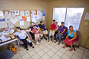 20 JUNE 2009 - PHOENIX, AZ: The waiting in room at the walk in clinic at the Cultural Cup. The walk in clinic at the Cultural Cup Food Bank started two years ago when Cultural Cup founder Zarinah Awad wanted to expand the food bank's outreach and provide basic medical care for the people who use the food bank. The clinic sees, on average, 7 - 11 patients a week. Awad said that as the economy has worsened since the clinic opened and demand has steadily increased. She attributes the growth to people losing their jobs and health insurance. The clinic is staffed by volunteers both in the office and medical staff. Adults are seen every Saturday. Children are seen one Saturday a month, when a pediatrician comes in. Awad, a Moslem, said the food bank and clinic are rooted in the Moslem tradition of Zakat or Alms Giving, the giving of a small percentage of one's income to charity which is one of the Five Pillars of Islam.   PHOTO BY JACK KURTZ
