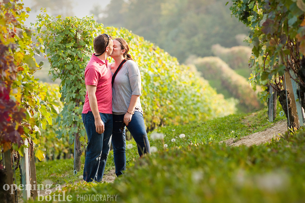 A romantic couple kisses in an Italian vineyard, in the famous wine region of Barolo, near La Morra (Piedmont), Italy. Model release available.