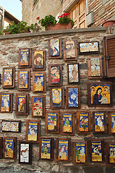 Display of hand-crafted majolica wall plaques at the shop Deruta Placens, a popular pottery shop in upper Deruta.