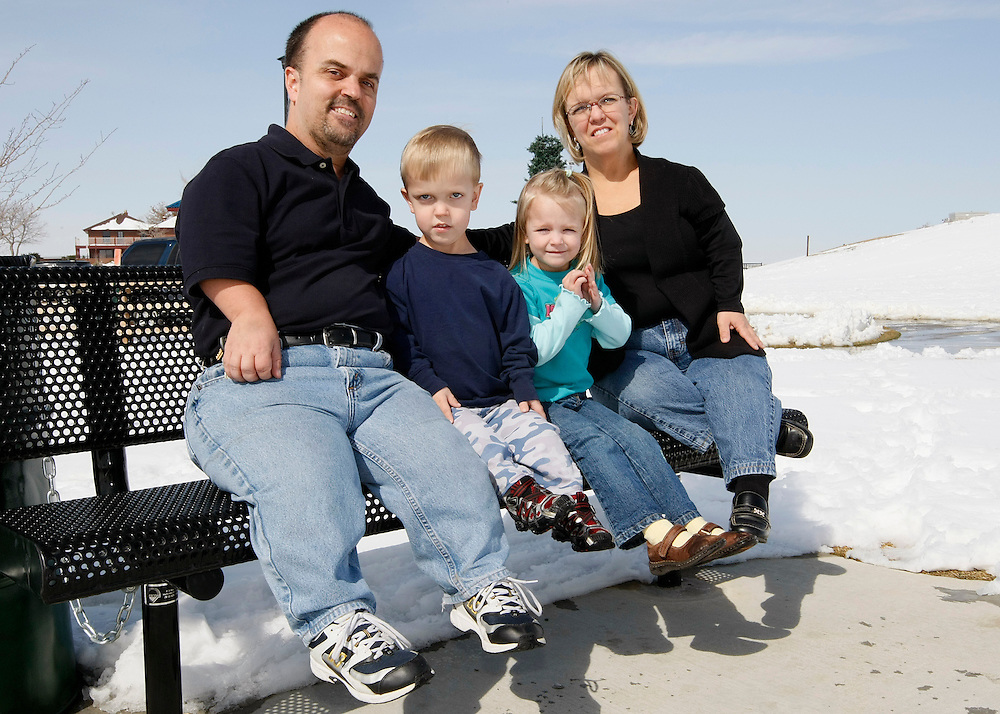 The Kotzian family poses for a picture in a park near their home in Thornton, Colorado March 25, 2010.  Chris (L), son Adam (2nd L), and Barb (R) are achondroplasia dwarfs while Avery (2nd R), 4 is average sized. Preferring to be called little persons Chris and Bard are active in the Little People of America, the only dwarfism support organization that includes all 200+ forms of dwarfism.  REUTERS/Rick Wilking (UNITED STATES)