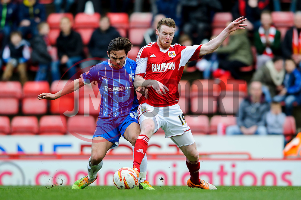 Bristol City Midfielder Stephen Pearson (SCO) is challenged by Gillingham Midfielder Bradley Dack (ENG) - Photo mandatory by-line: Rogan Thomson/JMP - 07966 386802 - 01/03/2014 - SPORT - FOOTBALL - Ashton Gate, Bristol - Bristol City v Gillingham - Sky Bet League One.