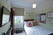 Guest bedroom from a contemporary refurbishment of a Victorian terrace house at 74 Ulverscroft Road, East Dulwich, London, England. Designed by Jo Houchell & architect Oliver Houchell, 2008